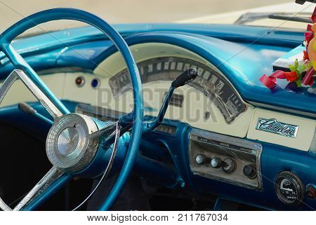 HAVANA, CUBA - OCTOBER 22, 2006: Interior of a blue vintage Cadillac car parked at the street in Havana, Cuba. American classic cars are often used as taxis for tourists in Havana.