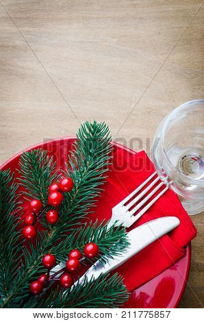 Festive Table Setting With Christmas Decorations on Rustic Wooden Background for Christmas Eve. Top View. Copy Space. Selective Focus.