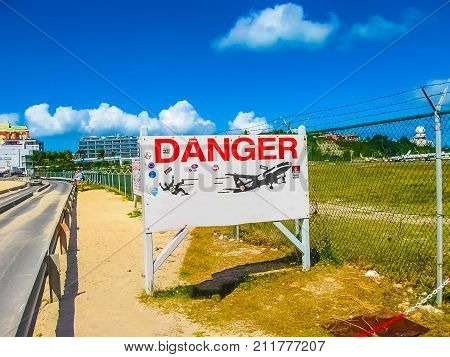 Philipsburg, Sint Maarten, Kingdom of the Netherlands - February 10, 2013: The road sign at beach at Maho Bay is one of the world's premier planespotting destinations.