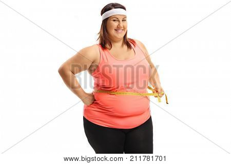Cheerful overweight woman measuring her waist with a measuring tape isolated on white background