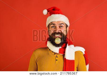 Santa Claus Holds Golden Ball For Fir Tree In Beard