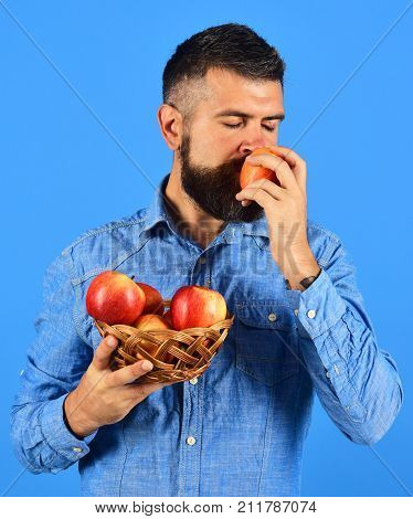 Farmer With Dreamy Face Smells Red Apples