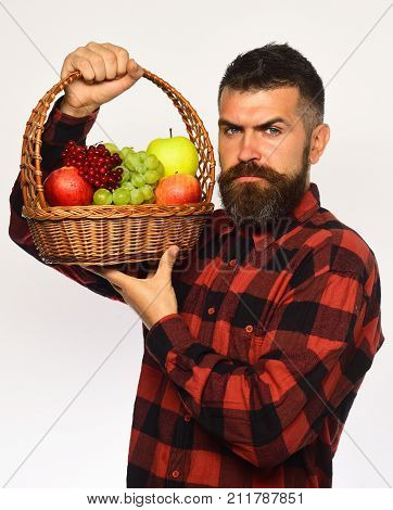Farmer With Serious Face Presents Apples, Grapes And Cranberries.