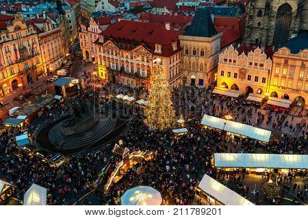 PRAGUE, CZECH REPUBLIC - DECEMBER 11, 2016: View from above on famous traditional Christmas market at Old Town Square illuminated and decorated for holidays in Prague - capital of Czech Republic.