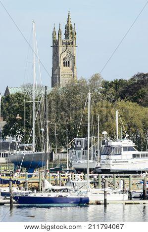 Fairhaven Massachusetts USA - November 1 2017: Unitarian Church towers over boatyard on Acushnet River in Fairhaven Massachusetts