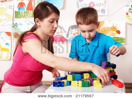 Child with construction in play room. Preschool. poster