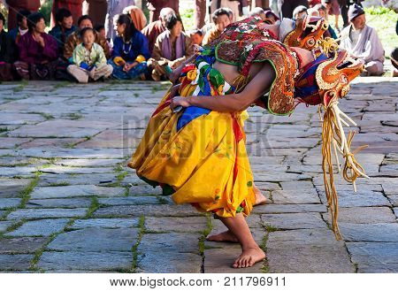BUMTHANG, BHUTAN - OCTOBER, 25, 2010 : Masked dancers in a traditional festival in Bumthang - Bhutan