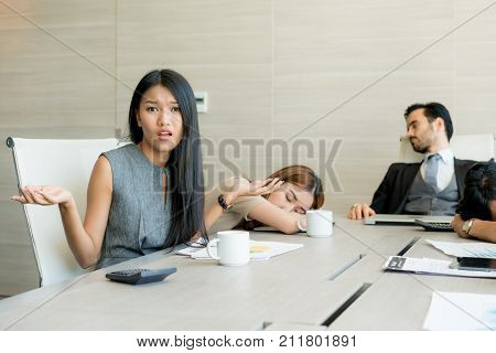 Bored business people and sleeping resting on workplace during work meeting concept of exhausted businesspeople bored sleep tired.