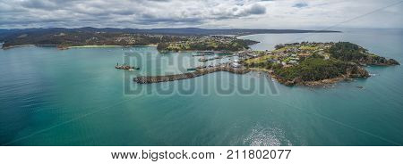 Aerial panorama of the lookout point where people watch for whales and wharf in Eden NSW Australia