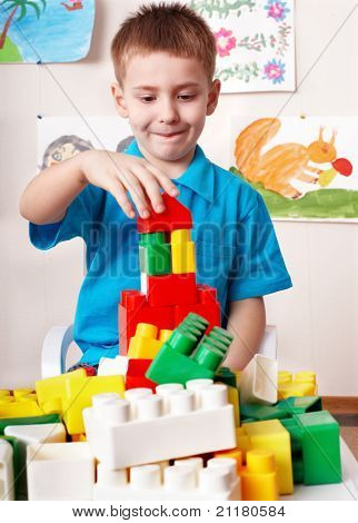 Little girl play construction set . poster