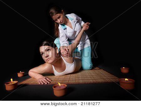 Beautiful white girl having thai massage.