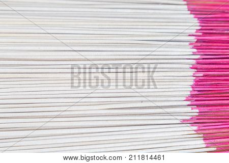 Close up picture of incense sticks use for worship in Buddhism and Hinduism in Asia.