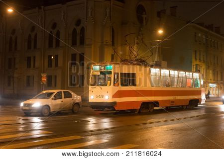 SAINT PETERSBURG, RUSSIA - NOVEMBER 03, 2014: Night tram in the center Saint Petersburg (between 1924 and 1991 named Leningrad). St. Petersburg was founded by Tsar Peter the Great on 1703.