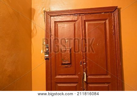 Typical old wooden door in a residential building built in the first half of the 20th century. Saint-Petersburg (between 1924 and 1991 named Leningrad) Russia.