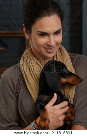 Portrait of a mature woman - mid adult woman holding dog.