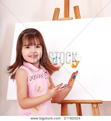 Little girl making handprints with paint.