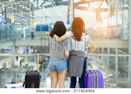 Traveler together in airport concept Young asian backpack with carrying hold luggage and passenger for tour travel booking ticket flight international vacation in holiday relaxation.