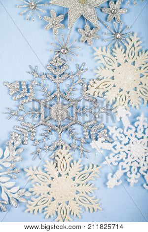 Silvery Snowflakes On A Wooden Background.