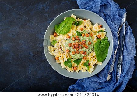 Vegan Farfalle Pasta With Spinach  Sauce With Fried Chickpeas. Proper Nutrition. Sports Nutrition. D