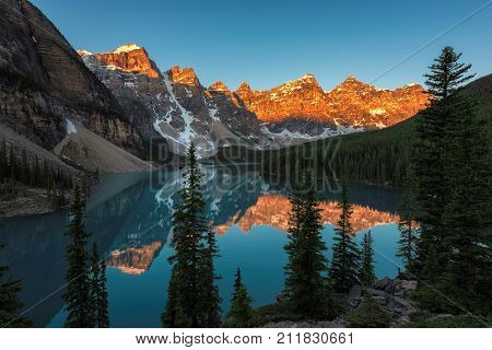 Sunrise under turquoise waters of the Moraine lake in Rocky Mountains, Banff National Park, Canada.