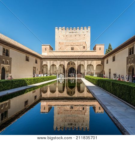GRANADA,SPAIN - OCTOBER 3,2017 - View at the Nazaries palace in Alhambra center of Granada. Granada is located at the foot of the Sierra Nevada mountains.