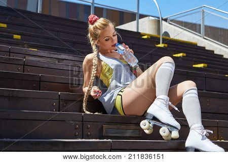 Sexy blonde riding on a retro roller
