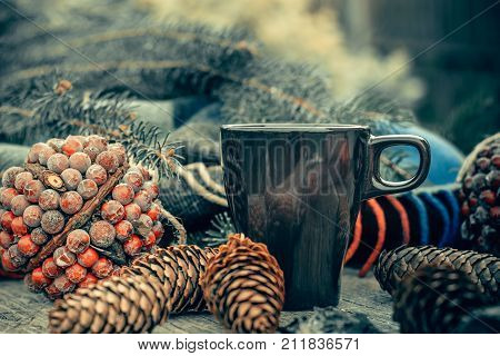 Cup Of Hot Tea On A Rustic Wooden Table. Still Life Of Cones, Twine, Patskthread, Fir Branches.