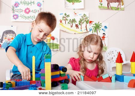 Children playing construction set . poster