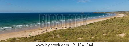 St Ives Bay beach Cornwall uk in summer with people blue sky and sea panoramic view