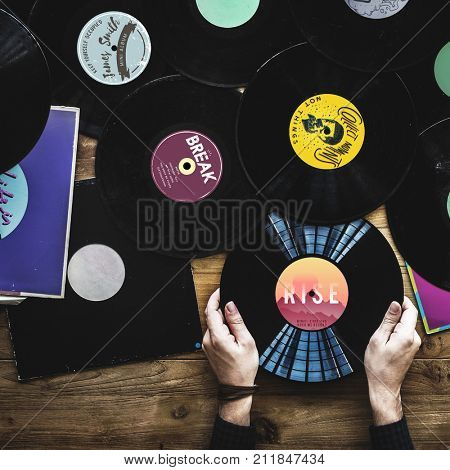 Hands holding music vinyl collectible record