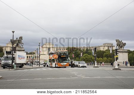 French People Driving And Biking With Travelers Walking And Traffic Road At Front Of Eiffel Tower Or