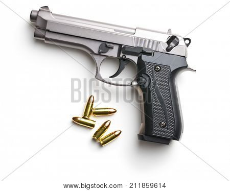 9mm pistol bullets and handgun isolated on white background.
