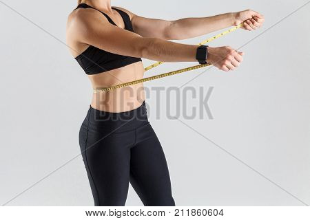 Motivation Concept. Woman Holding Centimeter On Her Stomach.