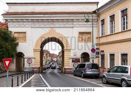 Brasov Romania October 06 2017 : The Shay Gate (Poarta Schei) consisting of three arches standing on the Gateway Schei Street (Strada Poarta Schei) in the Brasov city in Romania