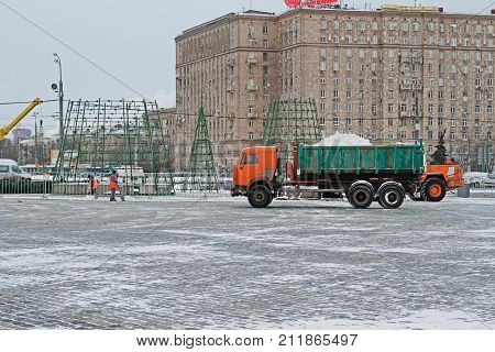 Moscow Russia - December 07 2016: Workers clean snow from sidewalks on Poklonnaya Hill in Moscow