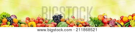Panoramic collection fresh fruits and vegetables on yellow background. Free space for text.
