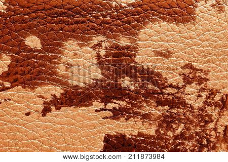abstract background of rough spotty texture of natural leather closeup red tone