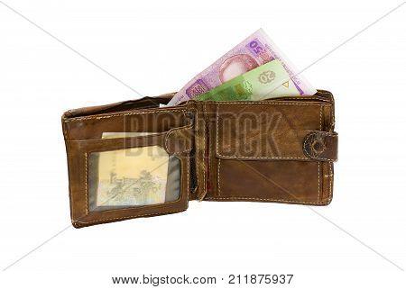 Worn wallet with Ukrainian money (hryvnia) .