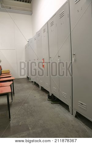 inside a factory locker with lockers and chairs