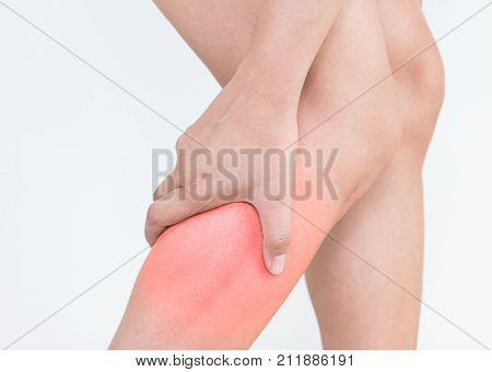 Young woman with calf leg pain on white background. Health concept
