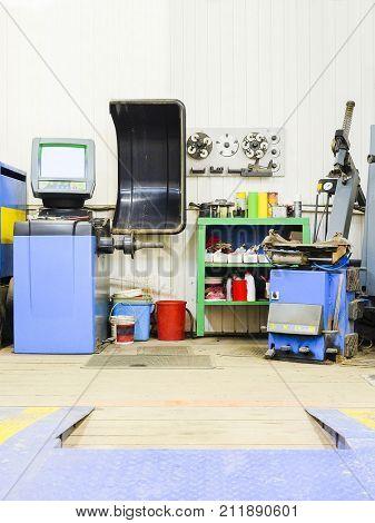 tyre repair equipment in a car repair station