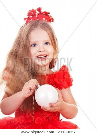 Little girl in red santa hat holding christmas ball. Isolated.