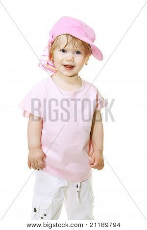 Cute Baby Girl In A Pink Cap Looks Into The Camera