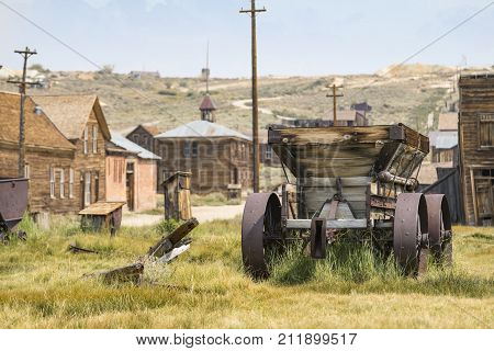 BODIE, CALIFORNIA, USA - August 31, 2017 : Old cart in Bodie ghost town, California. Bodie is a historic state park from a gold rush era in the Bodie Hills east of the Sierra Nevada