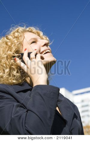 Business Woman Talks By A Mobile Phone