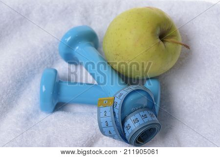 Health Regime And Fitness Symbols. Dumbbells Near Green Apple