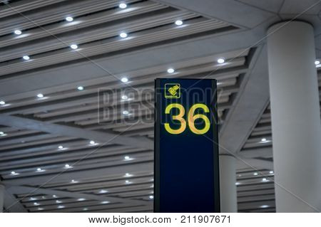 Airport arrival area baggage claim number sign board in departure area