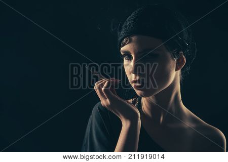Girl Smoking Cigarette In Mouthpiece, Vintage.