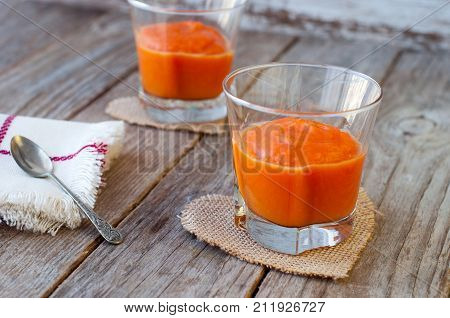 Puree From Sweet Pumpkin, Delicious Dessert. Homemade Pumpkin Puree In Glass On A Wooden Surface.