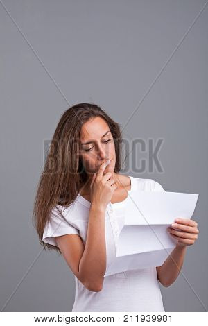Woman Thinking About That Letter